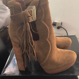 Tan suede fringe booties by Boutique 9